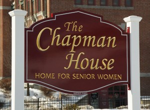 carved sign for Chapman House in Auburn, Maine